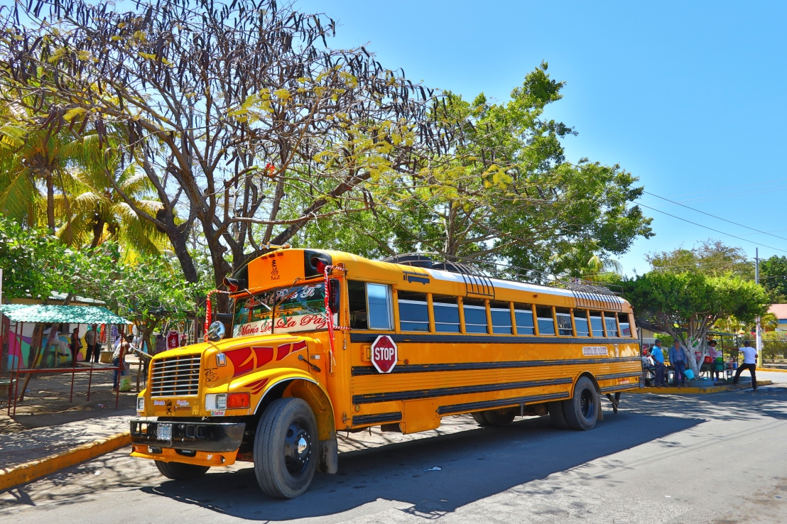 """<img src=""""chickenbus.jpg"""" alt=""""people and the old school bus typical for Central Americas"""">"""